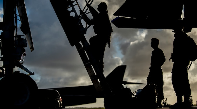 """Capt. """"HARM,"""" 9th Expeditionary Bomb Squadron B-1B Lancer weapons system officer instructor, climbs out of a B-1B at Andersen Air Force Base, Guam, May 22, 2020. This B-1B aircrew completed a 24-hour mission that included a large force exercise. The 9th EBS is deployed to Andersen Air Force Base, Guam, as part of a Bomber Task Force supporting Pacific Air Forces' strategic deterrence missions and  commitment to the security and stability of the Indo-Pacific region.(U.S. Air Force photo by Senior Airman River Bruce)"""
