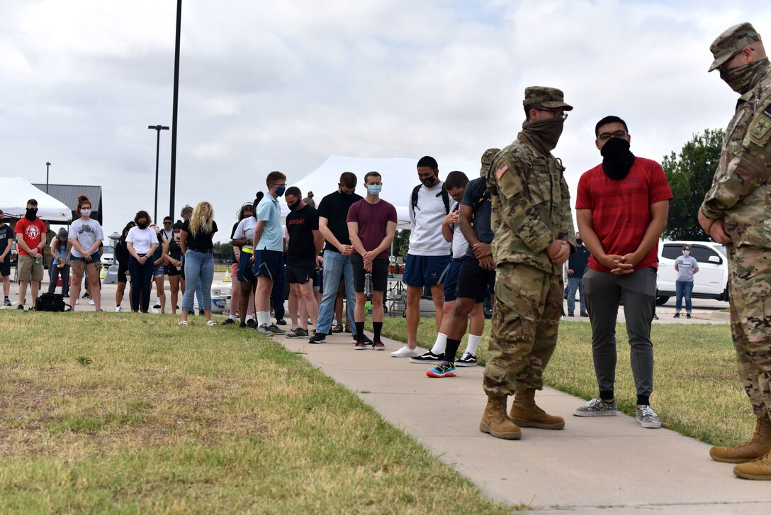 Goodfellow students observe a moment of silence during the Memorial Day BBQ at the Crossroads on Goodfellow Air Force Base, Texas, May 23, 2020. The BBQ was hosted by the Chapel and first sergeant council to let the students know they are thought about. (U.S. Air Force photo by Senior Airman Seraiah Wolf)
