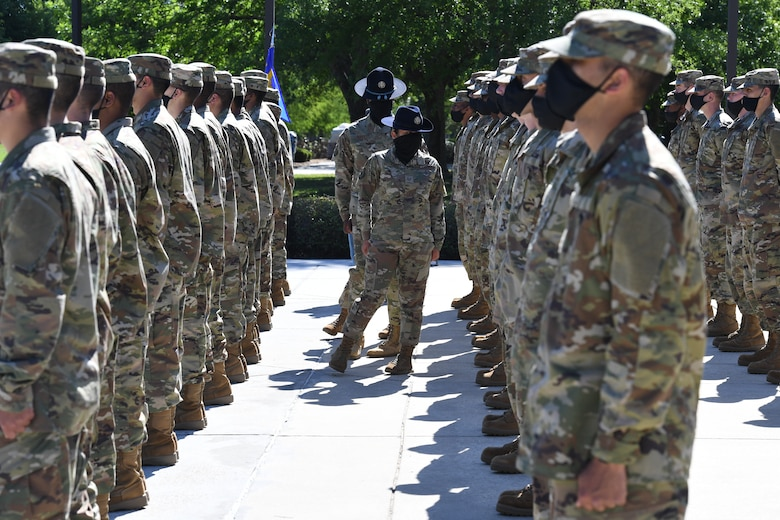 Military training instructor inspects ranks of Airmen