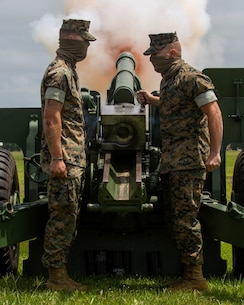 U.S. Marines with Alpha Battery, 1st Battalion, 10th Marines, 2d Marine Division host a 21-Minute Guns Salute while adhering to COVID-19 safety guidelines on Camp Lejeune, North Carolina, May 25, 2020. 
