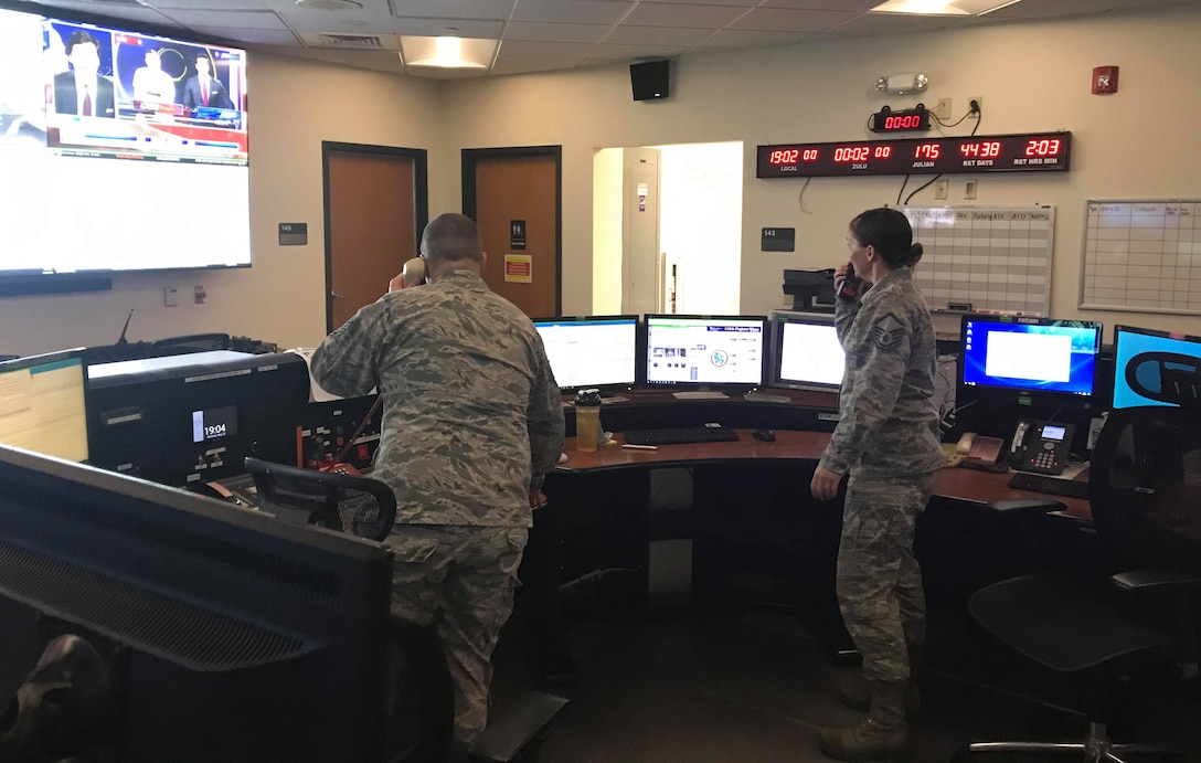 Command and control operations specialists work in the command post on base during the COVID-19 pandemic.