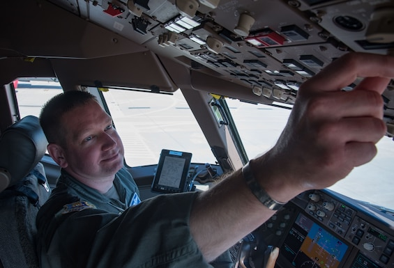 Col. Mark Baran, 22nd Air Refueling Wing vice commander, prepares for flight in a KC-46 Pegasus May 19, 2020, at McConnell Air Force Base, Kansas. Throughout Baran's career, he has worn the memorial bracelet for luck. He honors Lt. Col. Fredric M. Mellor, prior Missing in Action Vietnam pilot, and plans to send the bracelet to Mellor's family when he hangs up his flight suit. (U.S. Air Force photo by Senior Airman Michaela R. Slanchik)