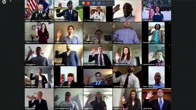 25 different people raise their right hand from their respective homes.