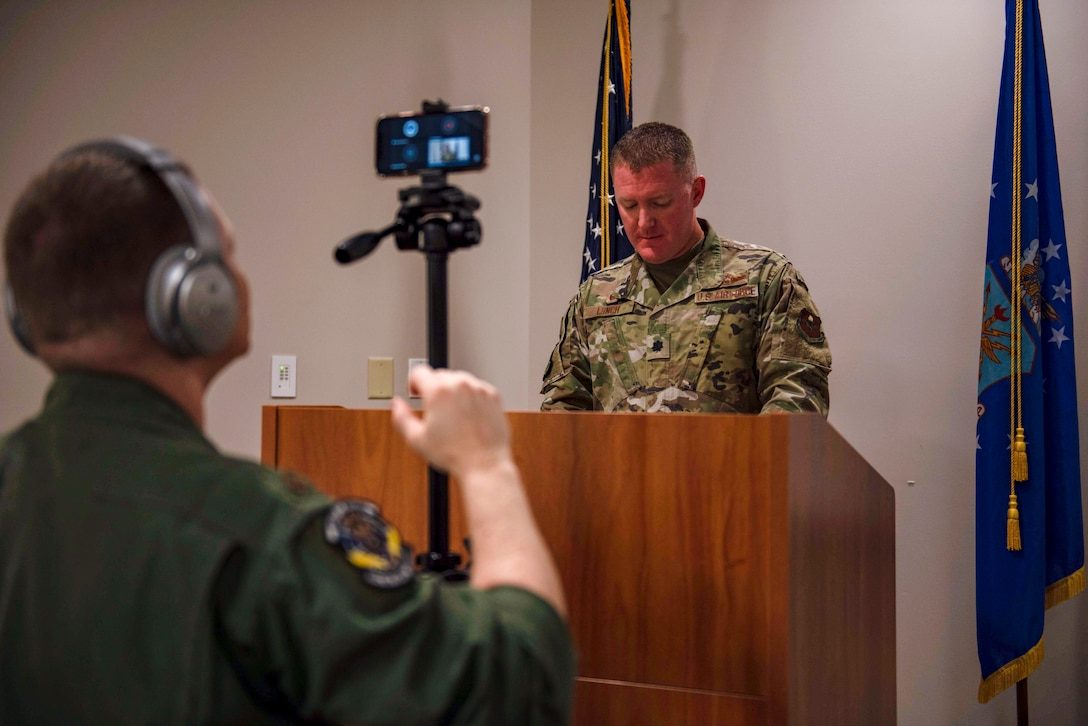 U.S. Air Force Maj. Jason Spicer, 337th Air Control Squadron, assistant director of operations, records U.S. Air Force Lt. Col. Michael Lynch, 337th ACS, commander, during a virtual ceremony held at the 337th ACS Air Battle Manager schoolhouse at Tyndall Air Force Base, Florida, May 26, 2020. The ceremony was held to honor the naming and dedication of Building 1285 after retired Gen. Lori Robinson who became the highest ranking ABM and the first female combatant commander in military history. (U.S. Air Force photo by Staff Sgt. Magen M. Reeves)