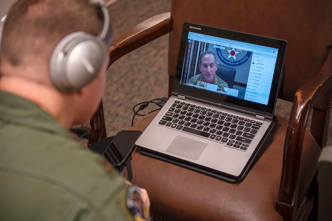 U.S. Air Force Maj. Jason Spicer, 337th Air Control Squadron, assistant director of operations, watches U.S. Air Force Chief of Staff Gen. David Goldfein during a virtual ceremony held at the 337th ACS Air Battle Manager schoolhouse at Tyndall Air Force Base, Florida, May 26, 2020. Goldfein was the guest speaker for the dedication event and honored retired Gen. Lori Robinson for whom Building 1285 was recently named after. (U.S. Air Force photo by Staff Sgt. Magen M. Reeves)