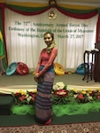 lady posing in front of banner in embassy of myanmar