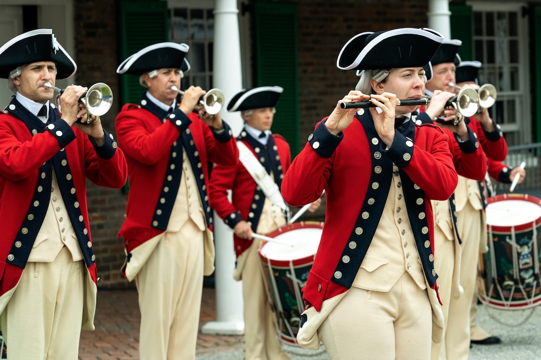 Soldiers perform during a ceremony.