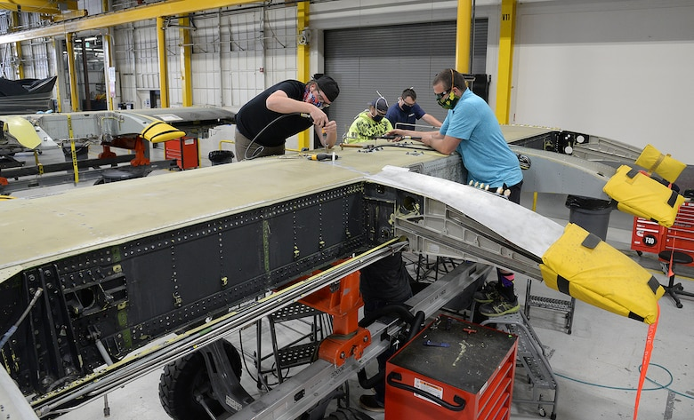 Sheet metal mechanics work an A-10 wing with newly manufactured parts May 5, 2020, at Hill Air Force Base, Utah. The skilled engineers and technicians of the 533rd CMMXS in the Ogden Air Logistics Complex, design, prototype and manufacture thousands of critical components annually, that can't be found anywhere else in the world.