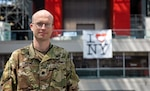 U.S. Army Lt. Col. (Dr.) G. Travis Clifton, Brooke Army Medical Center's chief of general surgery, poses in front of the Javits Convention Center in New York City, April 22, 2020. Clifton deployed to New York to help ease the burden on local hospitals by aiding COVID-19 and other patients at the Javits.