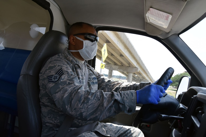 Staff Sgt. Aaron Antu, 433rd Logistics Readiness Squadron ground transportation operator answers a call for a vehicle to transport a COVID-19 monitored basic military training trainee, May 21, 2020 at Joint Base San Antonio-Lackland, Texas.