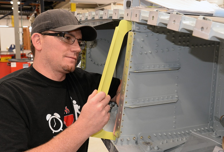 Donoviel Kolter fits a newly manufactured part into an A-10 wing May 5, 2020, at Hill Air Force Base, Utah. The skilled engineers and technicians of the 533rd CMMXS in the Ogden Air Logistics Complex, design, prototype and manufacture thousands of critical components annually, that can't be found anywhere else in the world. The parts are manufactured in order to bridge a gap in the regular supply system, when there's no contract in place from an outside source.