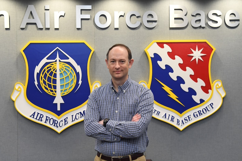 David Kedzierski, installation privatized housing resident advocate, poses for a photo on Hanscom Air Force Base, Mass., May 14. Kedzierski serves as a liaison between the privatized housing partner and residents to ensure quality housing and fair treatment for active duty members. (U.S. Air Force photo by Linda LaBonte Britt)