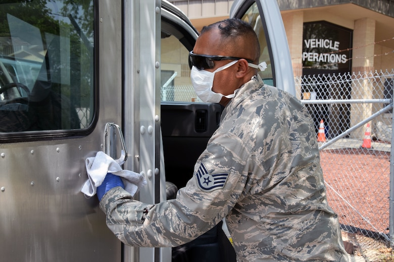 Staff Sgt. Aaron Antu, 433rd Logistics Readiness Squadron ground transportation operator, sanitizes a transportation vehicle being used to transport basic military training trainees who are being monitored for COVID-19 to and from medical facilities, May 21, 2020 at Joint Base San Antonio-Lackland, Texas.