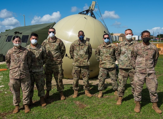 Airmen assigned to the 644th Combat Communications Squadron pose for a group photo at Naval Hospital, Guam, May 13, 2020.