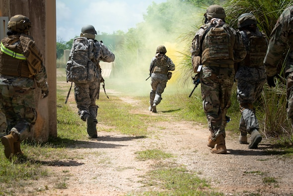 "Students in a Tactical Combat Casualty Care class run to secure a location during the ""care under fire"" portion of their training, May 13, 2020 at Andersen Air Force Base, Guam."