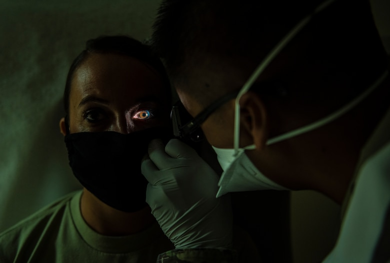 U.S. Air Force Capt. Everlino Ramos, 36th Medical Operations Squadron family health physician assistant, performs an eye exam on a patient at Andersen Air Force Base, Guam, May 16, 2020.
