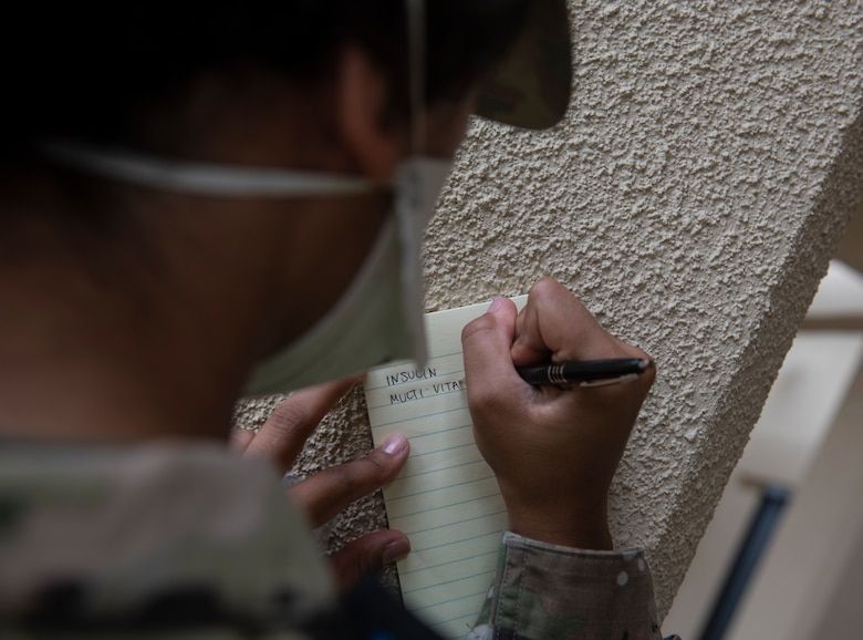 U.S. Air Force Senior Airman Patience Letourneau, 36th Medical Operations Squadron dental technician, writes down medication for a patient at Andersen Air Force Base, Guam, May 16, 2020.