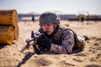 A recruit with Echo Company, 2nd Recruit Training Battalion participates in the Bayonet Assault course at Marine Corps Recruit Depot, San Diego, May 20, 2020.