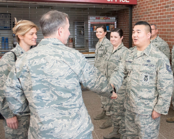 In this March 30, 2017 photo, Air Force Chief of Staff Gen. David L. Goldfein coins Tech. Sgt. Allen Nancarrow of the 102nd Security Forces Squadron, Massachusetts Air National Guard, at Otis Air National Guard Base. Goldfein served with Nancarrow's father, a retired master sergeant, in Italy. Allen Nancarrow is now a second lieutenant.