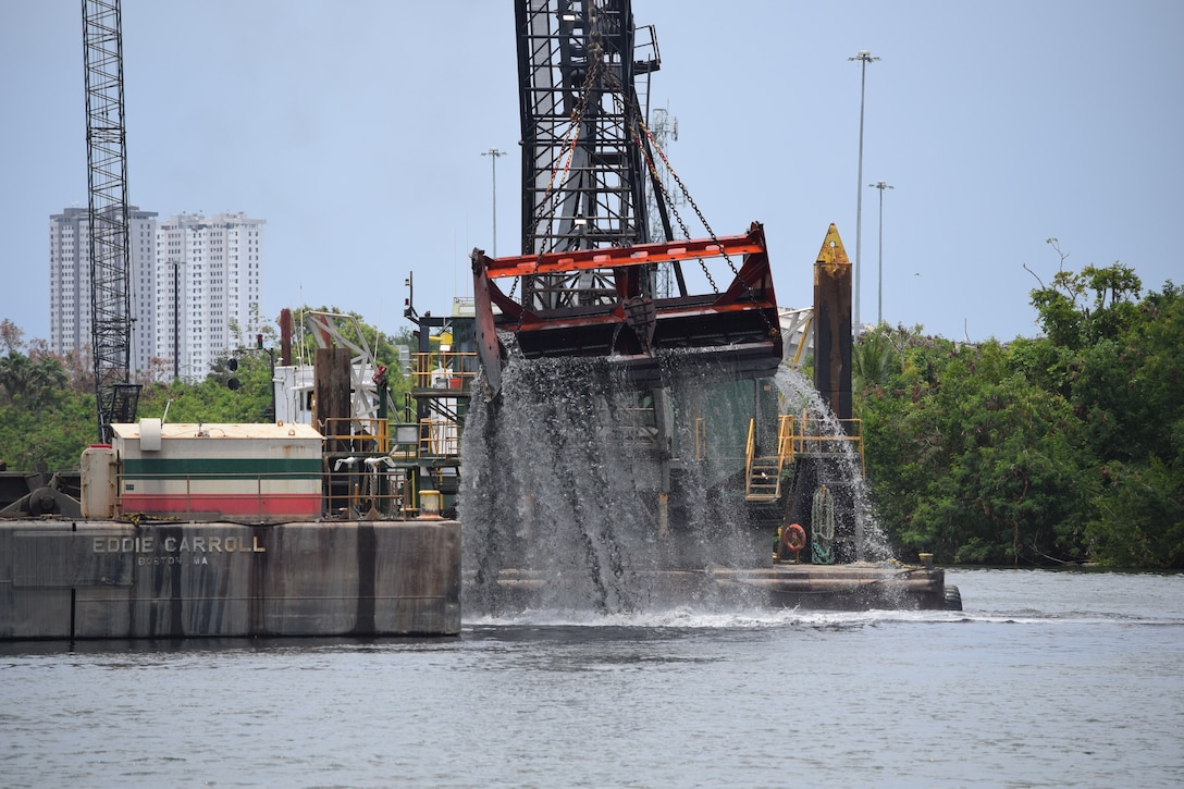 Hydraulic claw is seen coming off the water