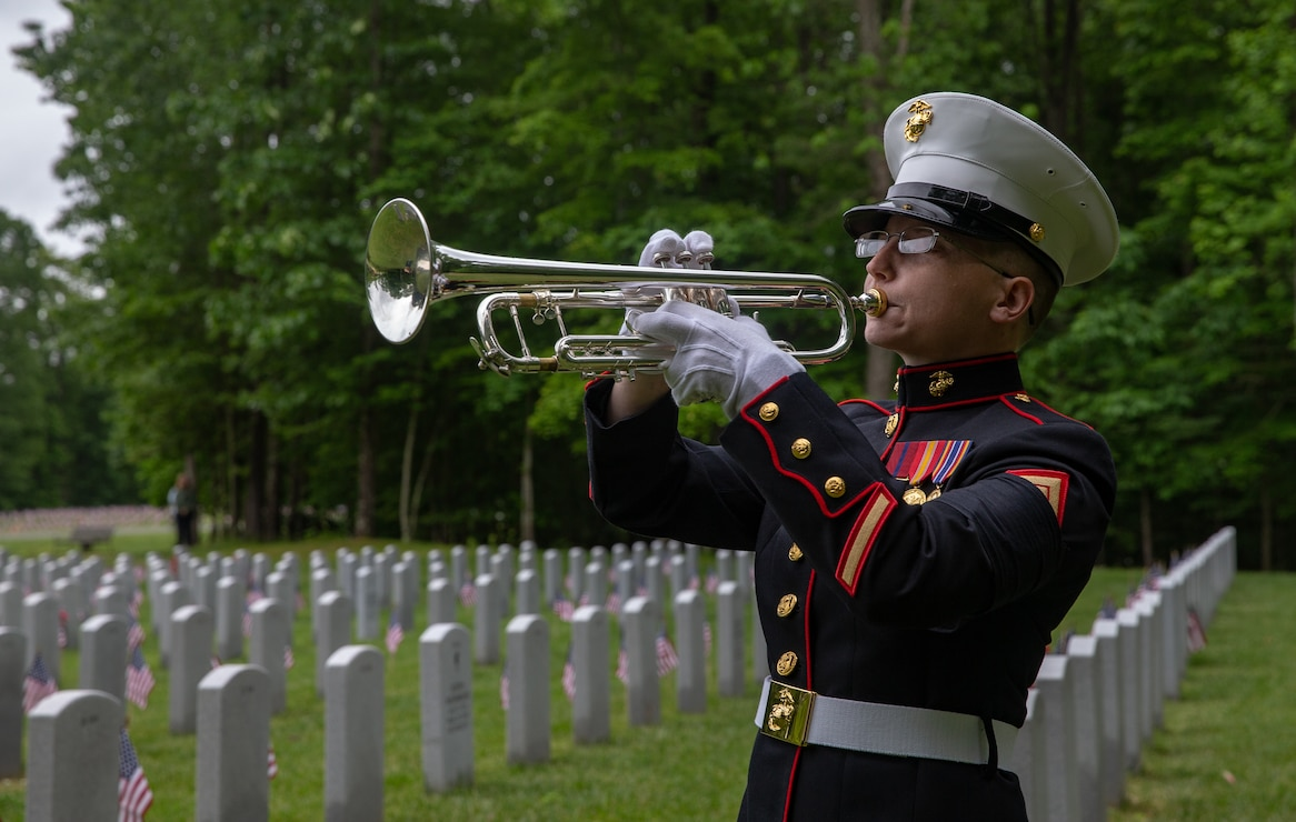 """A U.S. Marine plays """"Taps"""" during a Memorial Day Ceremony at the Quantico National Cemetery, Triangle, Va., May, 25."""