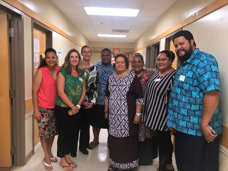 Jessica Podoski (second from left) and the American Samoa climate change working group pause for a photo with U.S. Congresswoman Aumua Amata (center) during the October 2019 workshop for the American Samoa Climate Related Vulnerability Assessment for Transportation Infrastructure Study.