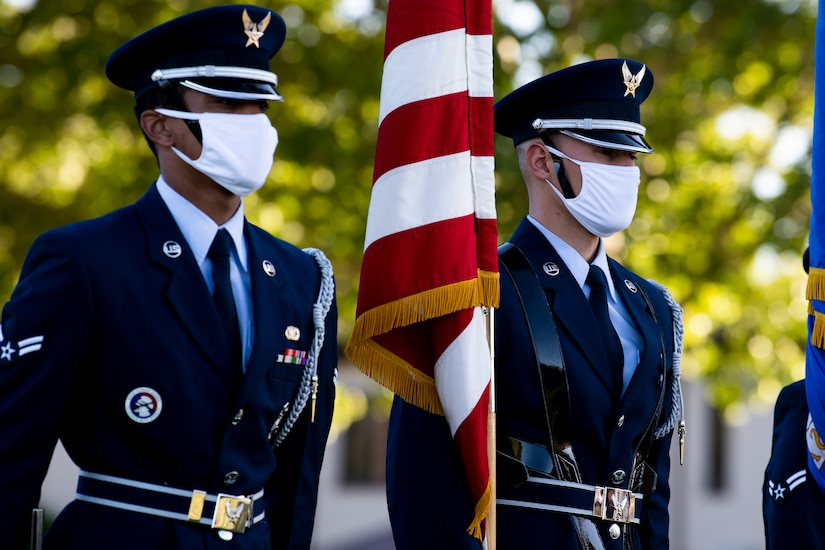 An Air Force honor guard at a high school graduation ceremony.
