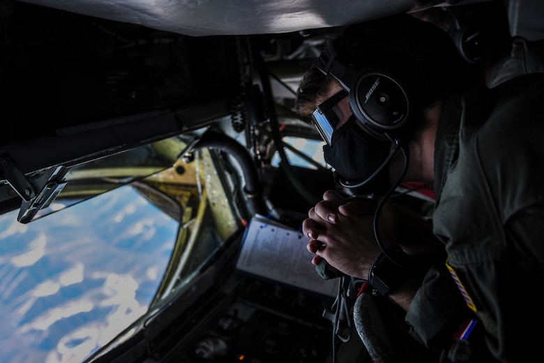 U.S. Air Force Airman 1st Class Jacob Ellis, a 93rd Air Refueling Squadron boom operator, waits for an inbound B-1B Lancer to receive fuel over Alaska, May 21, 2020. Bomber Task Force missions demonstrate the credibility of U.S. forces to address a diverse and uncertain security environment. The Airmen and crews from Dyess arrived at Andersen AFB May 1 to conduct BTF missions in the Indo-Pacific. (U.S. Air Force photo by Airman 1st Class Aaron Larue Guerrisky)