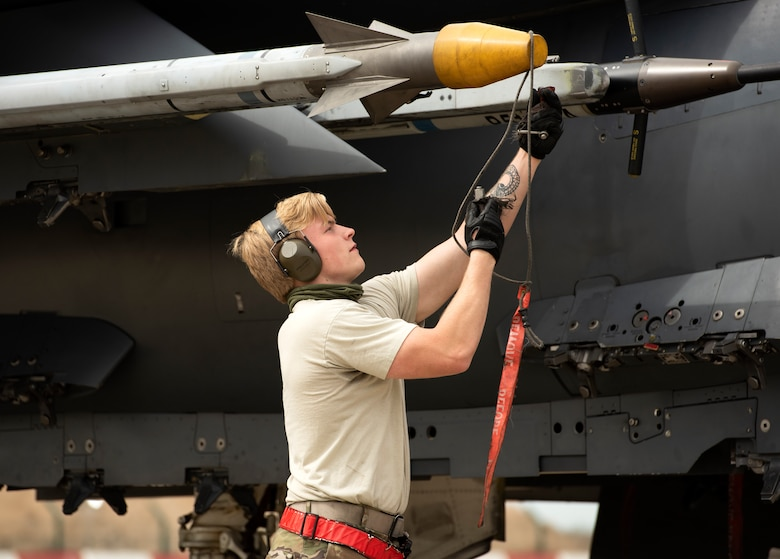 A crew chief assigned to the 494th Fighter Squadron Aircraft Maintenance Unit prepares an F-15E Strike Eagle for takeoff at Royal Air Force Lakenheath, England, May 27, 2020. During a large force exercise with other U.S. Air Forces in Europe-Air Forces Africa units, 48th Fighter Wing aircrew conducted Dissimilar Air Combat Training in order to enhance combat readiness and increase tactical proficiency needed to maintain a ready force capable of ensuring the collective defense of the NATO alliance. (U.S. Air Force photo by Airman 1st Class Jessi Monte)