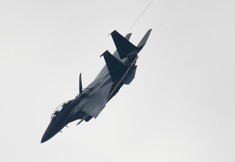 An F-15E Strike Eagle assigned to the 494th Fighter Squadron flies over Royal Air Force Lakenheath, England, May 27, 2020. U.S. Air Force F-15s assigned to the 48th Fighter Wing, F-16s assigned to the 31st Fighter Wing and 52nd Fighter Wing, and KC-135s assigned to the 100th Air Refueling Wing participated in a large force exercise within the U.K. North Sea airspace. (U.S. Air Force photo by Airman 1st Class Jessi Monte)