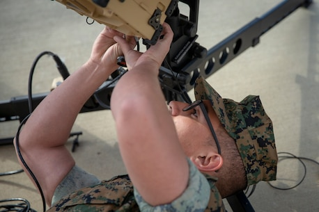 An SPMAGTF-SC Marine pieces together a rapid response kit for satellite communications at Marine Corps Base Camp Lejeune, North Carolina. Marines with SPMAGTF-SC are training with satellite communications equipment to enhance their capabilities for upcoming missions.
