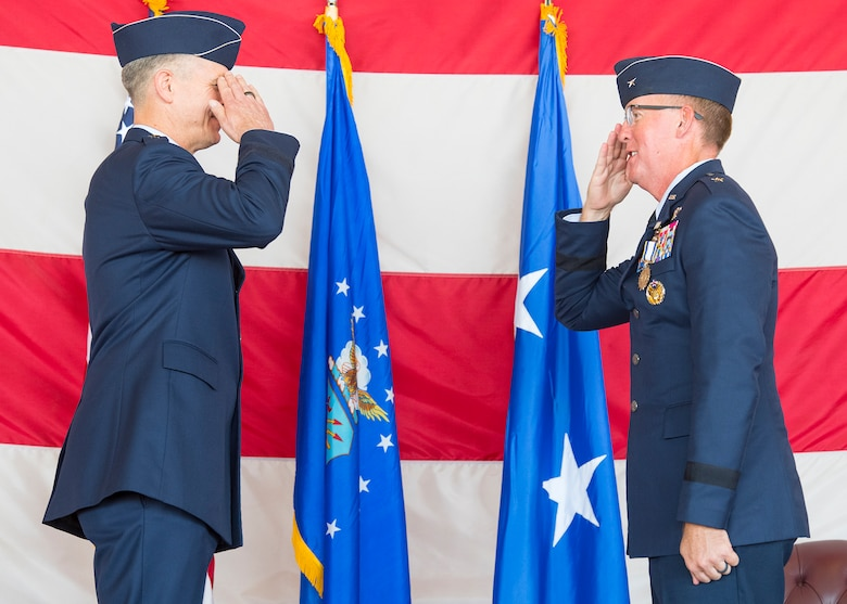 Brig. Gen. Todd Canterbury, 56th Fighter Wing outgoing commander (right), salutes Maj. Gen. Craig Wills, 19th Air Force commander, Joint Base San Antonio-Randolph, Texas, May 27, 2020, during the 56th FW Change of Command ceremony at Luke Air Force Base, Ariz.