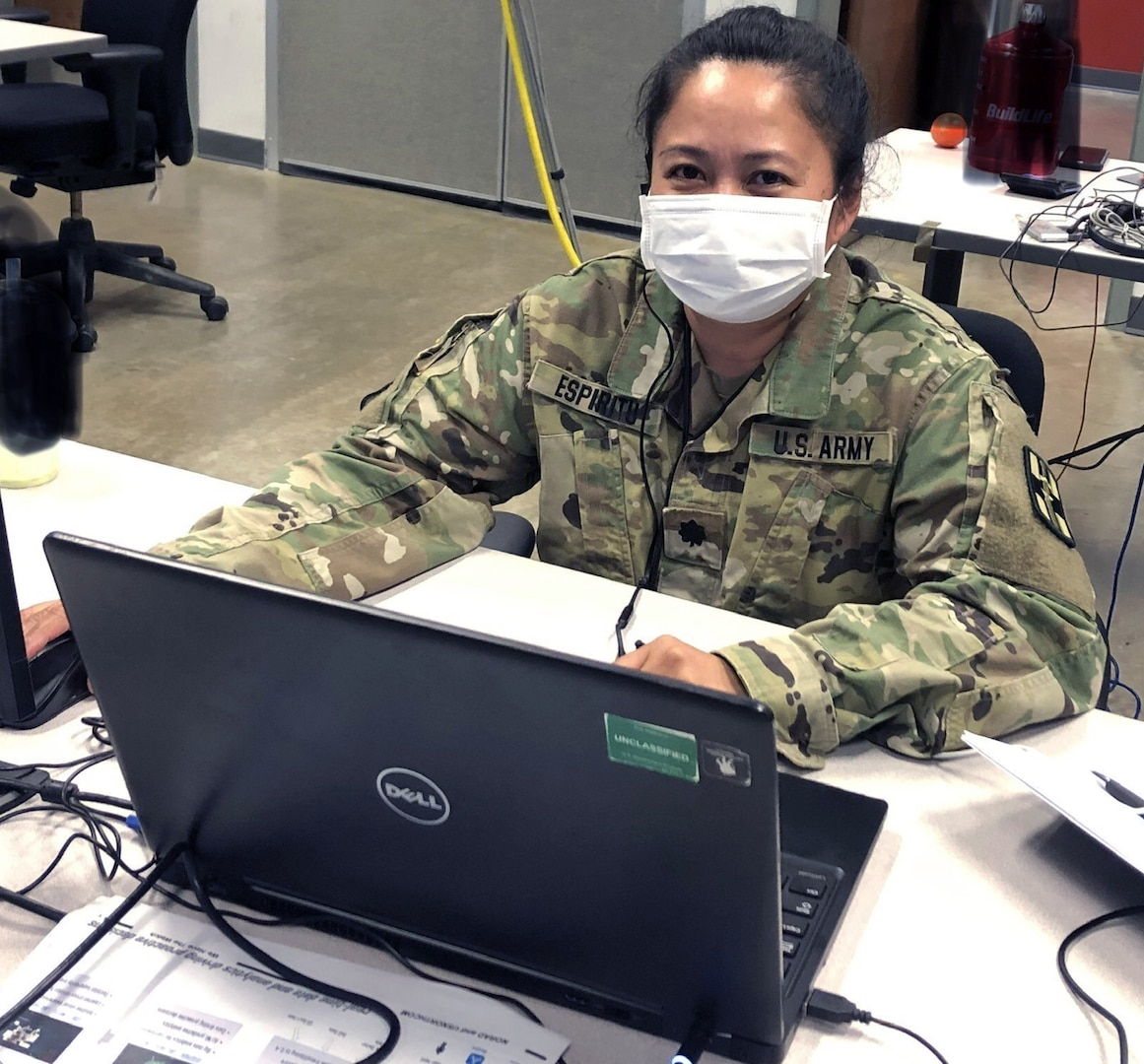 Lt. Col. Maria Espiritu, a clinical laboratory officer, works at Joint Base San Antonio-Fort Sam Houston April 20 in support of the Department of Defense COVID-19 Response mission. Espiritu provides guidance to multiple clinical laboratories in the U.S. that provide testing for military medical professionals mobilized to support areas heavily impacted by COVID-19.