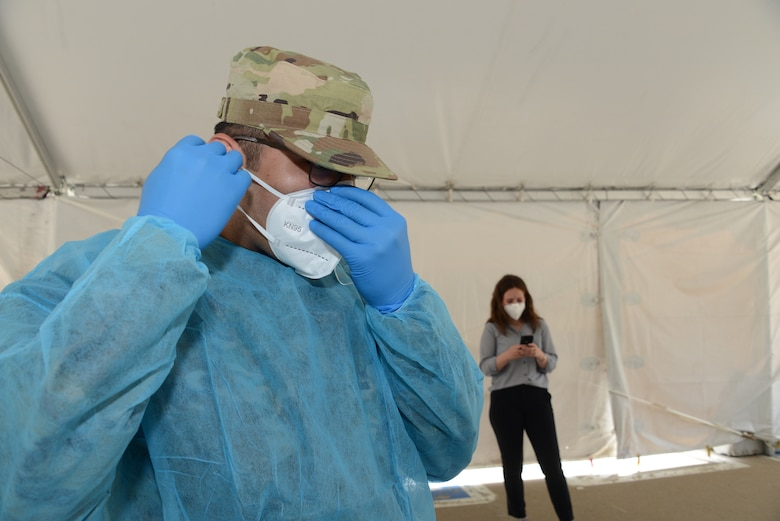"Members of the Iowa Air National Guard provide assistance at the ""TestIowa"" COVID-19 test site in Sioux Center, Iowa on May 27, 2020."