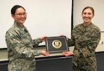 D.C. Air National Guardsman 2nd Lt. Deborah Ou-Yang poses for a photo with her instructor, Marine Capt. Skye Martin, at Public Affairs Qualification Course graduation. (Photo credit: Coast Guard PACS Kyle Niemi)