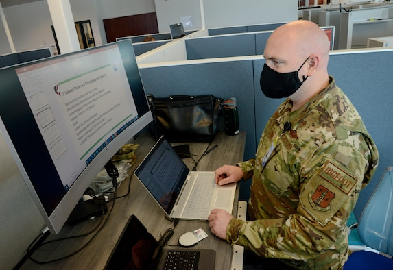Washington Air National Guard Maj. Brian Banke, a chaplain with the Western Air Defense Sector, functions as the training manager for the COVID-19 mapping mission for the Washington National Guard at the Washington State Department of Health (DOH) offices in Tumwater, Washington, May 15, 2020. The Washington National Guard is supporting the DOH to prevent the spread of the coronavirus as Washington prepares to move to reopening parts of the state.