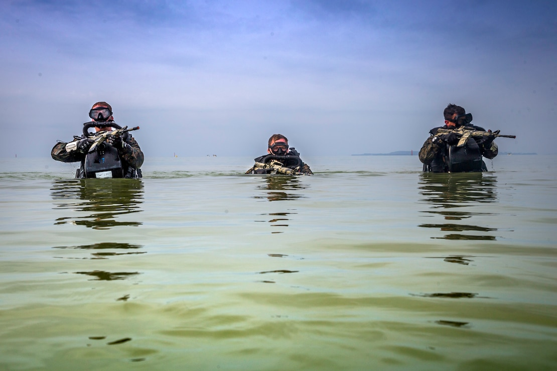 U.S. Marines patrol through water during a Marine Corps combat diving supervisor course at Camp Schwab, Okinawa, Japan, May 20.