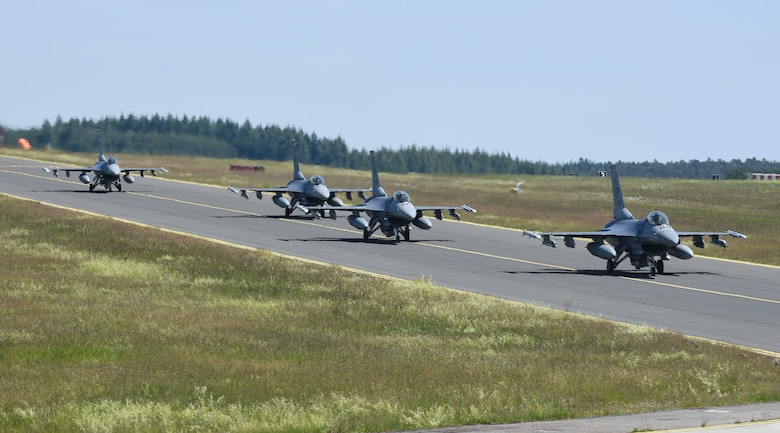 U.S. Air Force F-16 Fighting Falcons, assigned to the 480th Fighter Squadron, taxi off at Spangdahlem Air Base, Germany, to participate in a large force exercise within the North Sea airspace, U.K., May 27, 2020. Multiple wings from across U.S. Air Forces in Europe participated in the LFE, demonstrating the U.S. Air Force's ability to integrate different aircraft. (U.S. Air Force photo by Senior Airman Melody W. Howley)