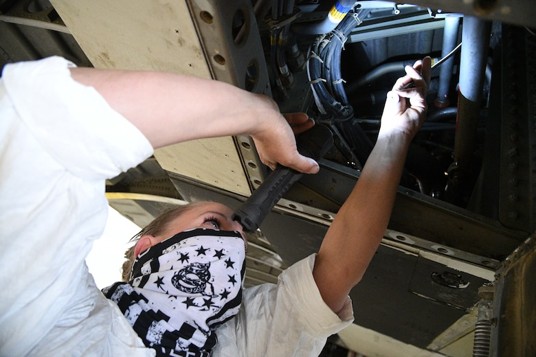 Shannon Ballenger, 309th Aircraft Maintenance Group aircraft mechanic, inspects an assembly on a C-130 wing at Hill Air Force Base, Utah, May 8, 2020. Comprised of seven maintenance squadrons and more than 2,000 personnel, the 309th AMXG performs depot maintenance, repair and overhaul on A-10, C-130, F-16, F-22, F-35 and T-38 airframes. (U.S. Air Force photo by R. Nial Bradshaw)