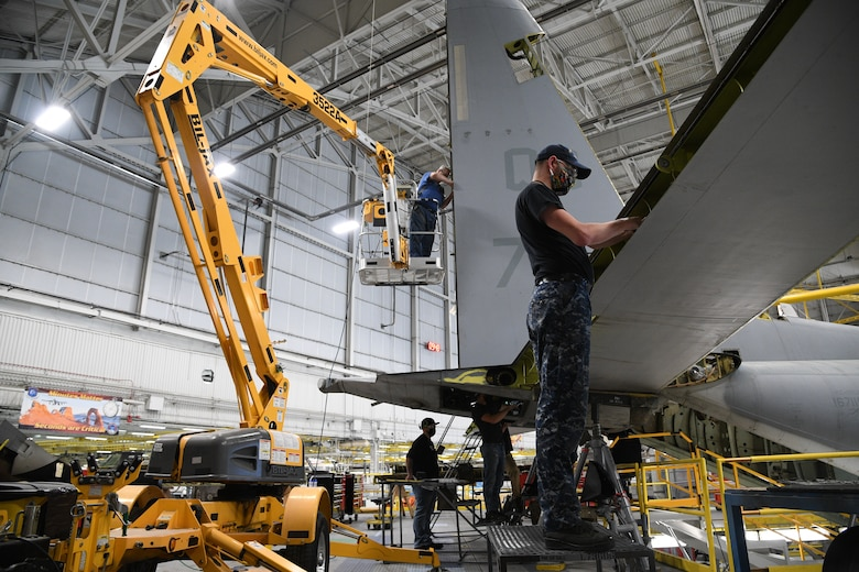 A 309th Aircraft Maintenance Group crew perform depot maintenance on a C-130 at Hill Air Force Base, Utah, May 8, 2020. Comprised of seven maintenance squadrons and more than 2,000 personnel, the 309th AMXG performs depot maintenance, repair and overhaul on A-10, C-130, F-16, F-22, F-35 and T-38 airframes. (U.S. Air Force photo by R. Nial Bradshaw)