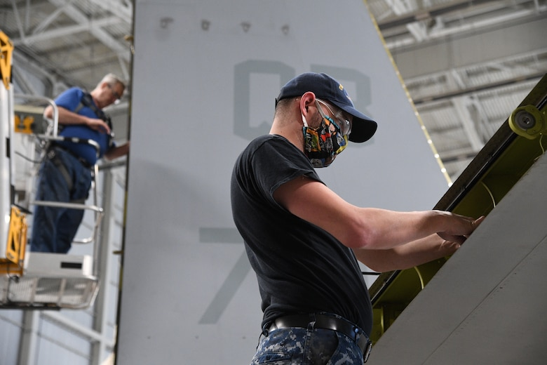 Jared Chidester, 309th Aircraft Maintenance Group aircraft mechanic, works on a C-130 at Hill Air Force Base, Utah, May 8, 2020. Comprised of seven maintenance squadrons and more than 2,000 personnel, the 309th AMXG performs depot maintenance, repair and overhaul on A-10, C-130, F-16, F-22, F-35 and T-38 airframes. (U.S. Air Force photo by R. Nial Bradshaw)