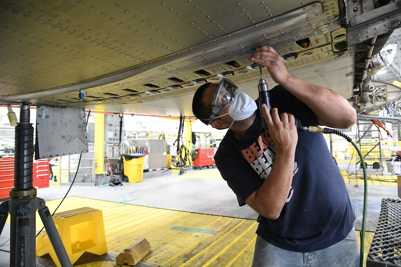 Joe Reyes, 309th Aircraft Maintenance Group sheet metal mechanic, reams a fastener hole on a C-130 wing at Hill Air Force Base, Utah, May 8, 2020. Comprised of seven maintenance squadrons and more than 2,000 personnel, the 309th AMXG performs depot maintenance, repair and overhaul on A-10, C-130, F-16, F-22, F-35 and T-38 airframes. (U.S. Air Force photo by R. Nial Bradshaw)