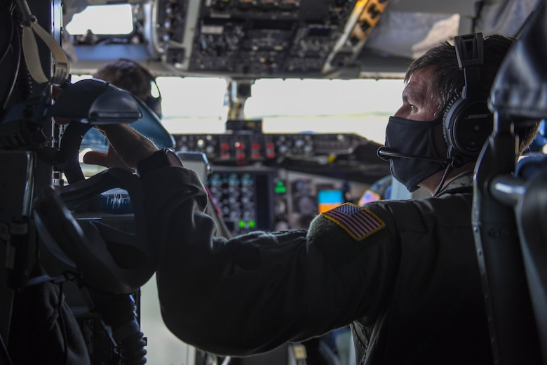 U.S. Air Force Senior Master Sgt. Ryan Clauss, a 93rd Air Refueling Squadron instructor boom operator, prepares for take off at Eielson Air Force Base, Alaska, May 21, 2020. During the flight, Clauss refueled a B-1B Lancer to support a long-range, long-duration Bomber Task Force mission over Alaska and near Japan. In Alaska, the B-1s were joined by F-22s and F-16s out of the 3rd Wing at Joint Base Elmendorf-Richardson, to conduct a large force employment exercise in the Joint Pacific Alaska Range Complex. (U.S. Air Force photo by Airman 1st Class Aaron Larue Guerrisky)