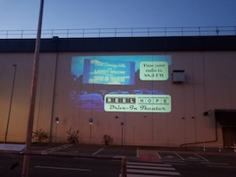 Image of a screen for a makeshift drive-in movie theater.