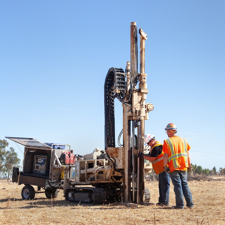 Contractors use a drilling rig with a sensor-tipped tube to sniff out potential contaminants at a former missile site.