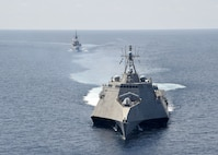 SOUTH CHINA SEA (May 25, 2020) The Independence-variant littoral combat ship USS Gabrielle Giffords (LCS 10), front, exercises with the Republic of Singapore Navy Formidable-class multi-role stealth frigate RSS Steadfast (FFS 70) in the South China Sea, May 25, 2020. Gabrielle Giffords, part of Destroyer Squadron Seven, is on a rotational deployment, operating in the U.S. 7th Fleet area of operations to enhance interoperability with partners and serve as a ready-response force.