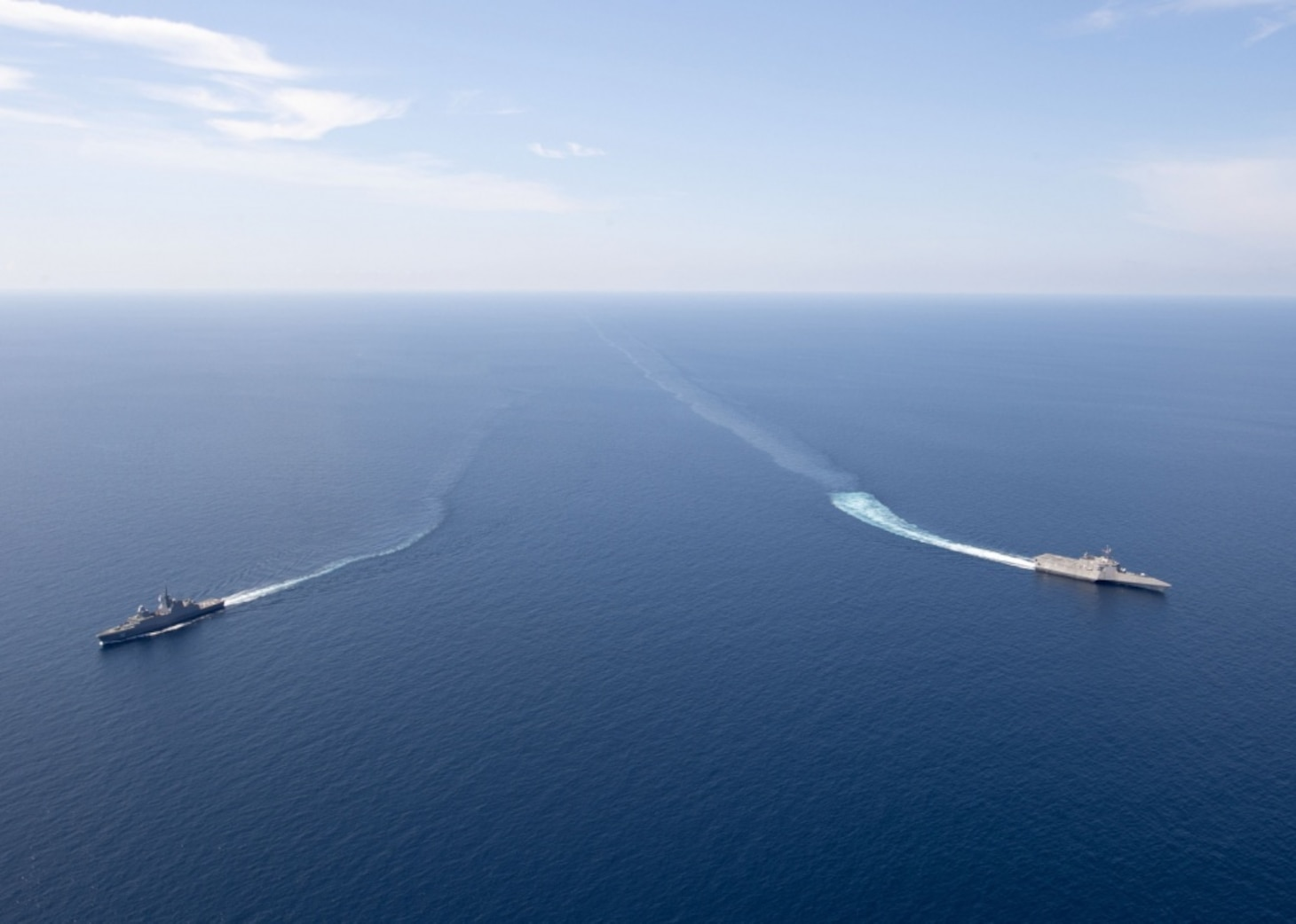 SOUTH CHINA SEA (May 25, 2020) The Independence-variant littoral combat ship USS Gabrielle Giffords (LCS 10), right, exercises with the Republic of Singapore Navy Formidable-class multi-role stealth frigate RSS Steadfast (FFS 70) in the South China Sea, May 25, 2020. Gabrielle Giffords, part of Destroyer Squadron Seven, is on a rotational deployment, operating in the U.S. 7th Fleet area of operations to enhance interoperability with partners and serve as a ready-response force.