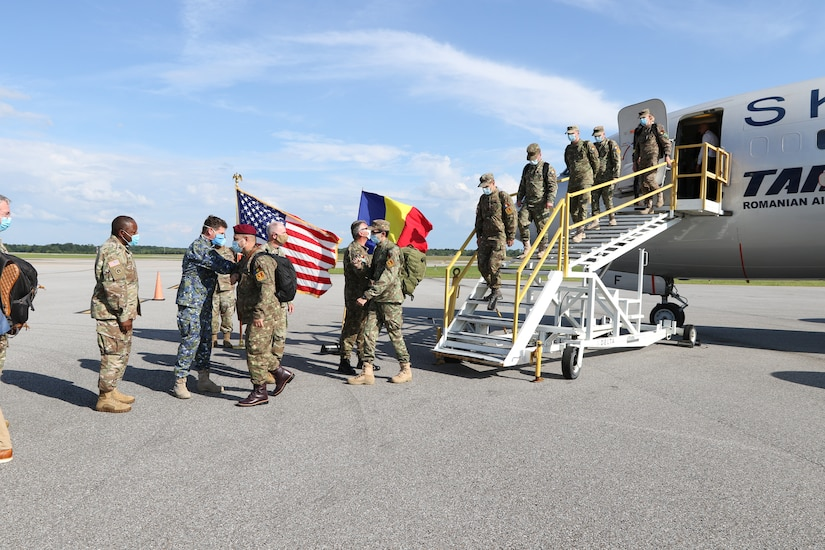 Florin Gheorghe IGNAT, assistant defense, military, naval, and air attaché, welcomes members of the Romanian Ministry of National Defense to Montgomery, Alabama, May 25, 2020. The Romanian team is assisting the Alabama National Guard in COVID-19 response as part of the National Guard's State Partnership Program.