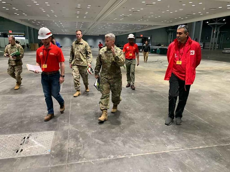 U.S. Army Corps of Engineers Commanding General and 54th U.S. Army Chief of Engineers Lt. Gen. Todd T. Semonite and U.S. Army Engineer Research and Development Center's Cold Regions Research and Engineering Laboratory Research Associate Army 1st Lt. Eoghan Matthews walk through the Jacob K. Javits Convention Center in New York, New York, March 26, 2020. The Javits Center is being used as an alternative care facility and was assembled by USACE to provide additional support during the COVID-19 outbreak.