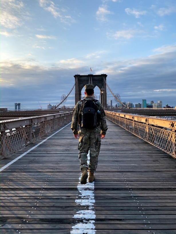U.S. Army Engineer Research and Development Center's Cold Regions Research and Engineering Laboratory Research Associate Army 1st Lt. Eoghan Matthews walks across the Brooklyn Bridge on his way to work at the U.S. Army Corps of Engineers (USACE) New York District, March 26, 2020.  Matthews was activated to assist the USACE New York District with completing site assessments, which are provided to local, state and federal partners, so that decisions can be made about where and when alternate care facilities are constructed as additional support to hospitals during the COVID-19 outbreak.